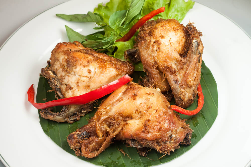 tasty fried chicken served hot on a plate