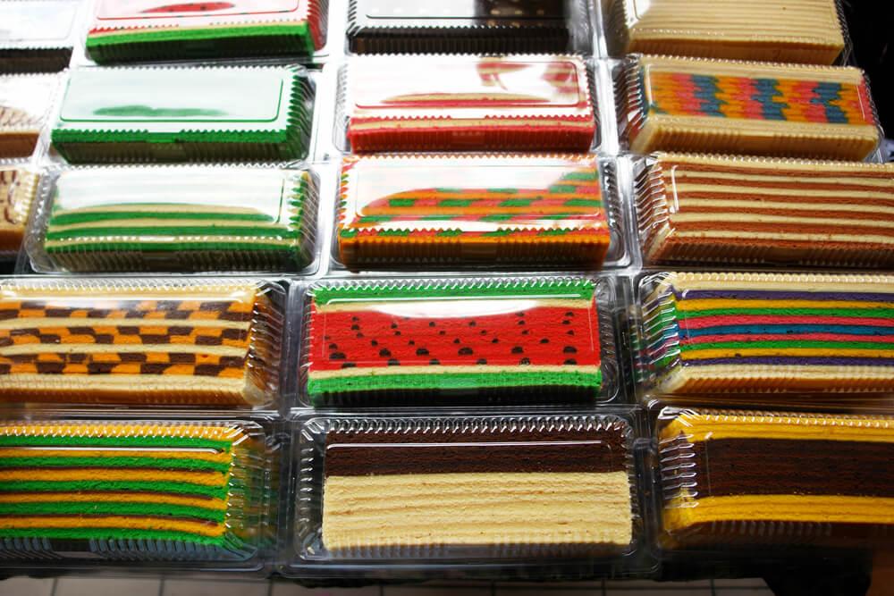 an array of colourful tasty kek lapis
