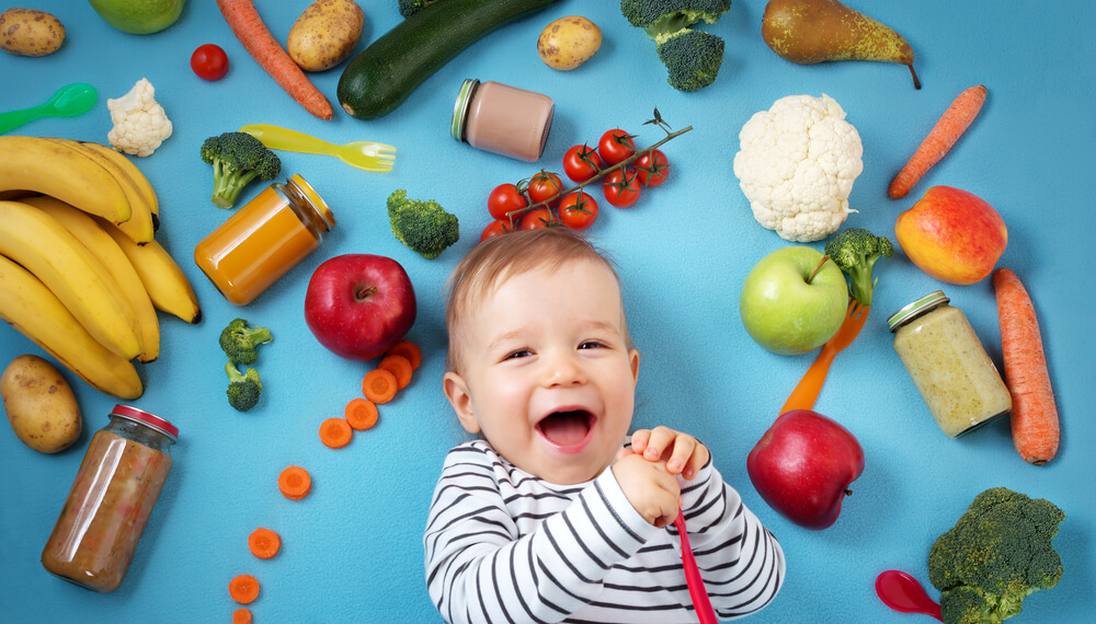cute baby surrounded by foods