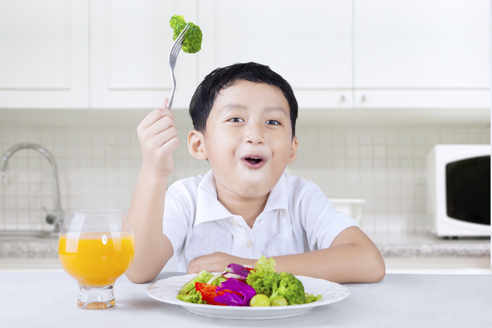 Boy eating healthy food