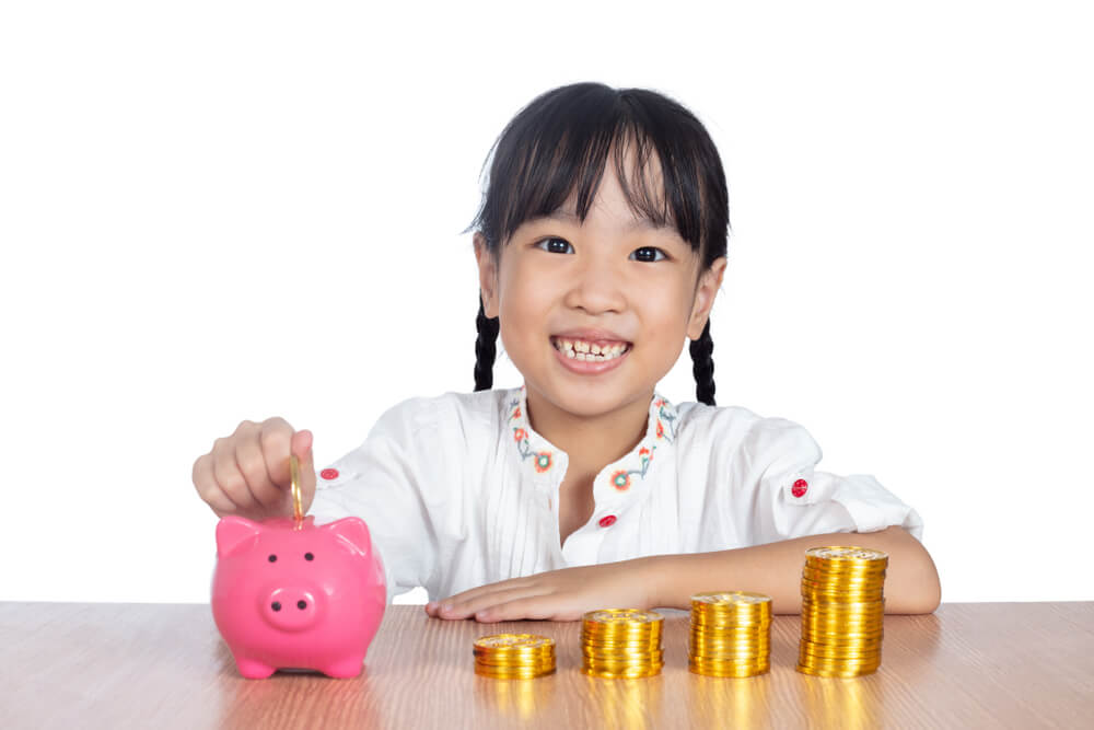 Child learning the value of money.