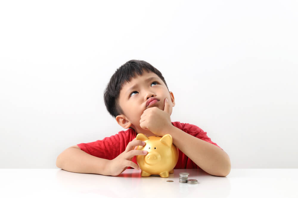 Boy thinking about the value of money before spending.