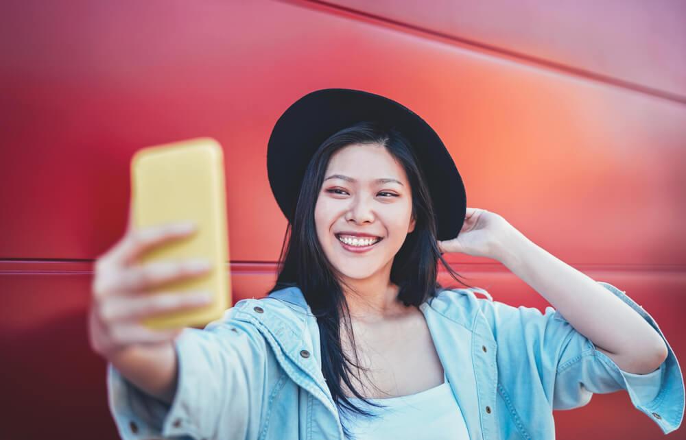 Millennial woman taking a selfie.