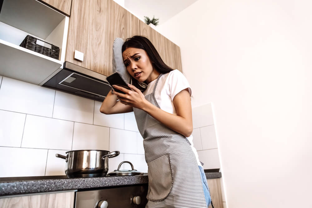 Woman confused while learning to cook