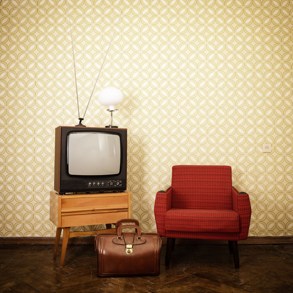 Old televisions with antenna.