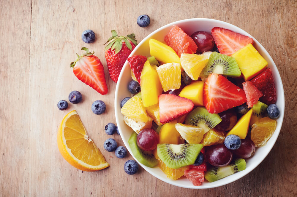 A bowl of colourful fruits and berries