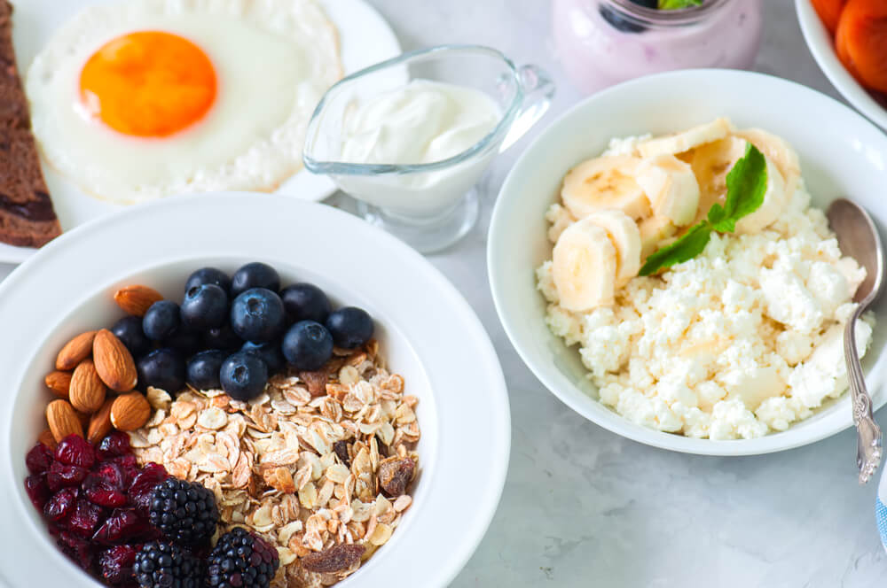 A healthy meal with fruits, oats, and eggs
