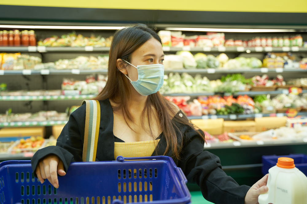 Woman with face mask shopping at AEON.