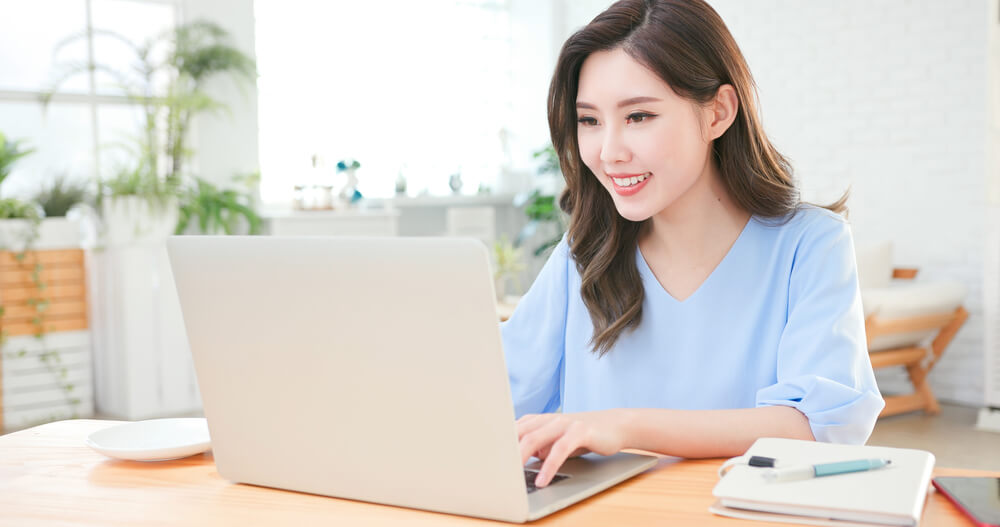 Asian woman use computer to work